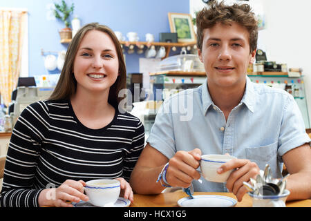 Group Of Portrait Of Teenage Couple Meeting In Cafe Stock Photo