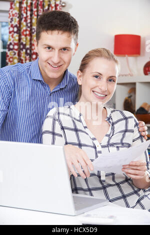 Couple Discussing Domestic Finances At Home - Stock Photo