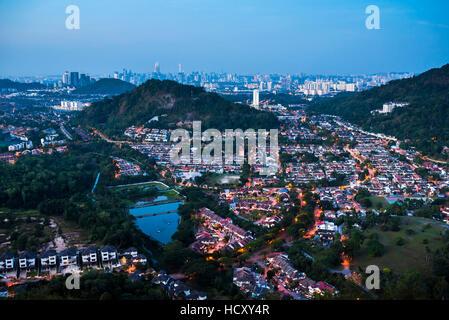 Kuala Lumpur skyline at night seen from Bukit Tabur Mountain, Malaysia - Stock Photo
