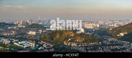 Kuala Lumpur skyline seen at sunrise from Bukit Tabur Mountain, Malaysia - Stock Photo