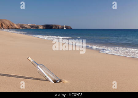 Message in a bottle, Playa Papagayo beach, near Playa Blanca, Lanzarote, Canary Islands, Spain, Atlantic - Stock Photo