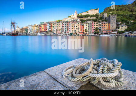 View from the pier of blue sea which frames the typical houses of Portovenere, UNESCO, La Spezia Province, Liguria, - Stock Photo