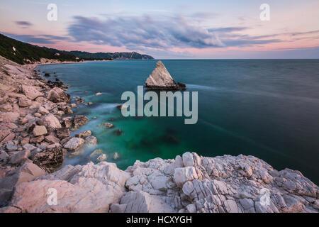 White cliffs frame the turquoise sea at sunrise, La Vela Beach, Portonovo, province of Ancona, Conero Riviera, Marche, - Stock Photo