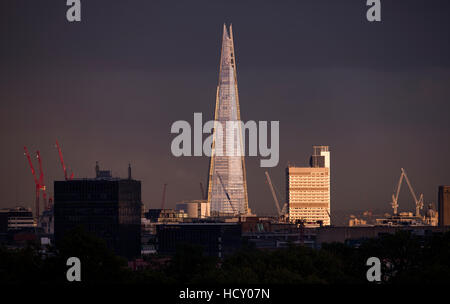 The Shard at sunset from the top of Primrose Hill in London, UK - Stock Photo