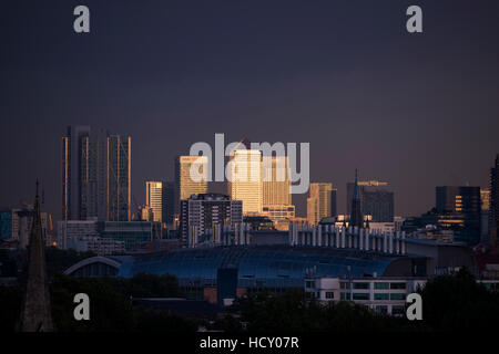 Canary Wharf, Docklands, at sunset from the top of Primrose Hill, London, UK - Stock Photo