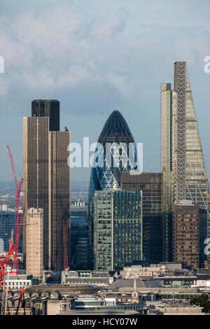 A view of the City of London including Tower 42, Swiss Re (The Gerkin), and Leadenhall Building (The Cheesegrater), - Stock Photo