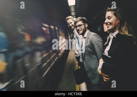 Business people waiting for metro in subway - Stock Photo
