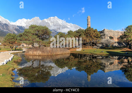 Chinese landscape with the Jade Dragon Snow Mountain in Yunnan on background - Stock Photo