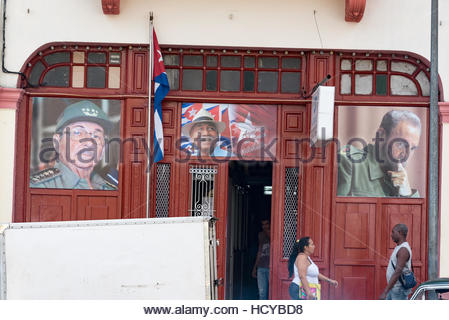 Juan Almeida Bosque image (center)  along Fidel Castro (right)  and Raul Castro (left)  photos in old buildings - Stock Photo
