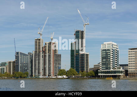 New apartments and tower blocks under construction alongside the RIver Thames in Lambeth London UK