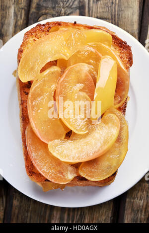 Caramelized apples on toast bread, sweet sandwich, top view, close up