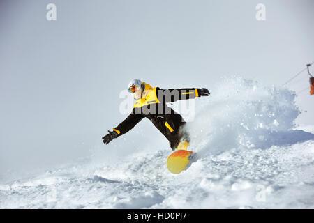 Snowboarder speed riding extreme ski - Stock Photo