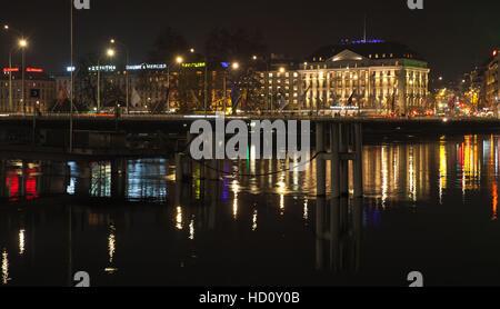 Geneva, Switzerland - November 24, 2016: Night cityscape with illuminated facades in central area of Geneva city - Stock Photo