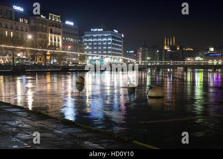 Geneva, Switzerland - November 24, 2016: Night cityscape with illuminated building facades of Geneva city - Stock Photo