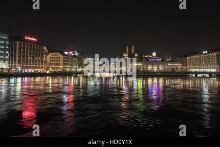 Geneva, Switzerland - November 24, 2016: Night cityscape with illuminated building facades in central area of Geneva - Stock Photo