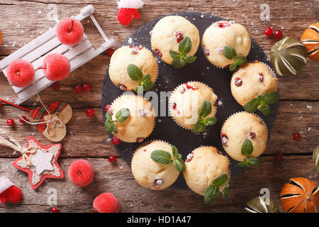 cranberry muffins with mint and Christmas decoration close-up on the table. horizontal view from above - Stock Photo