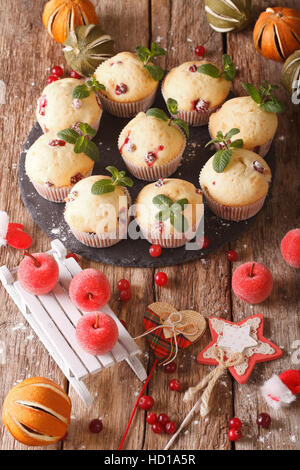 cranberry muffins with Christmas decorations close-up on the table. Vertical - Stock Photo