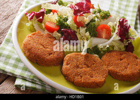 Dietary carrot burgers and fresh salad mix close-up on a plate. horizontal - Stock Photo
