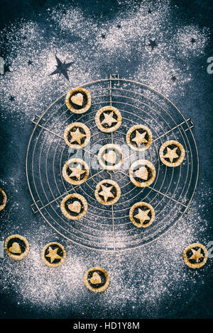 Baked homemade mini mince pies in the shape of a christmas tree with hearts and stars - Stock Photo