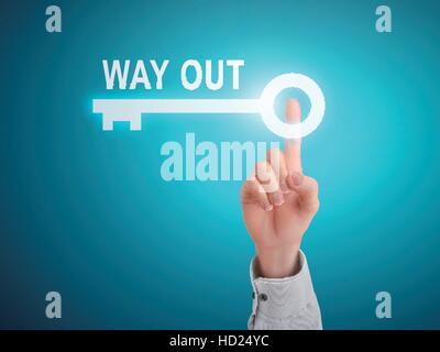 male hand pressing way out key button over blue abstract background - Stock Photo
