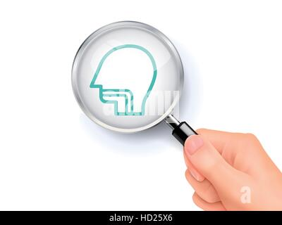 ENT clinic icon showing through magnifying glass held by hand - Stock Photo