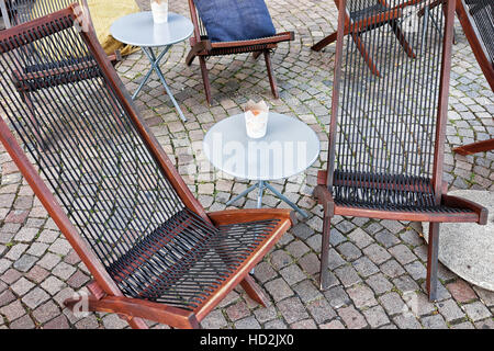 Typical restaurant terrace with chairs and tables at the expensive resort in Switzerland. - Stock Photo