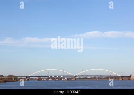 work on bridge over river merwede near gorinchem in holland with blue sky - Stock Photo