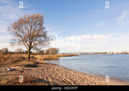 river merwede near sleeuwijk and gorinchem and bridge over highway A27 in holland - Stock Photo