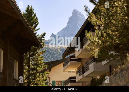 Chalets of resort city Zermatt with Matterhorn mountain in Switzerland in summer. - Stock Photo