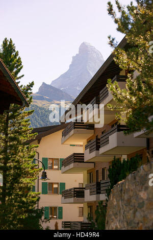 Chalets of resort city Zermatt with Matterhorn mountain of Switzerland in summer. - Stock Photo