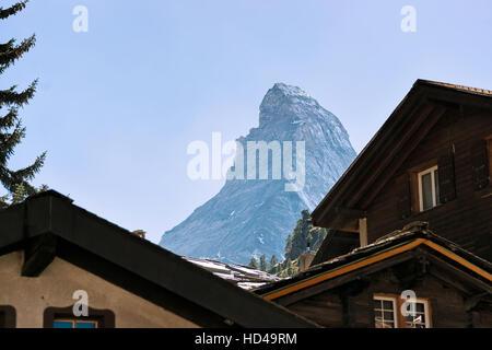 Roof tops of Chalets of resort city Zermatt with Matterhorn mountain in Switzerland in summer. - Stock Photo