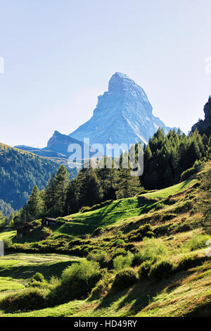 Matterhorn mountain and green valley with chalets in Zermatt of Switzerland in summer. - Stock Photo