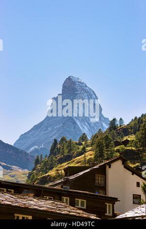 Roof tops of Chalets of resort city Zermatt with Matterhorn mountain, Switzerland in summer. - Stock Photo