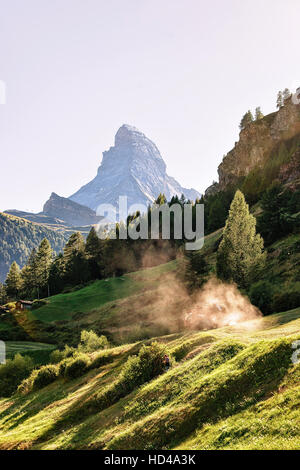 Matterhorn mountain and agricultural works in Zermatt, of Switzerland in summer. With special rays of light and - Stock Photo