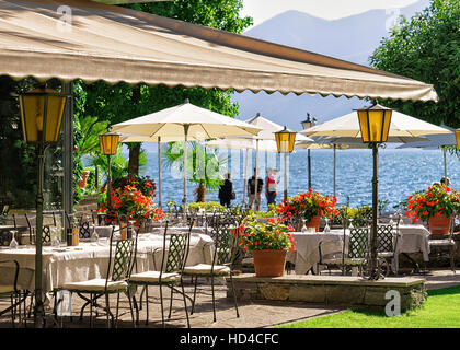 Ascona, Switzerland - August 23, 2016: Typical restaurant terrace with chairs and tables ready for a meal at the - Stock Photo