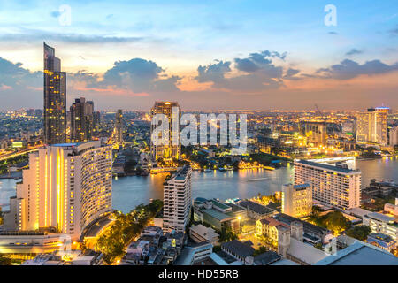 Twilight sky view in Bangkok. taken picture on 37 floor lebua building .front is Thonburi  district - Stock Photo