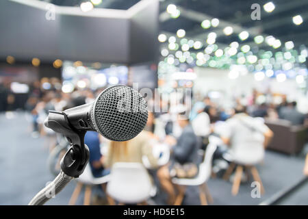 Microphone with abstract blurred photo of conference hall or seminar room with attendee and bokeh, Business meeting - Stock Photo