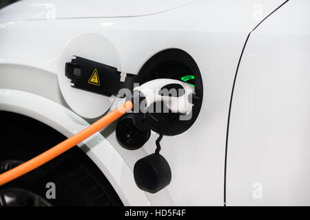 Power supply for hybrid electric car charging battery. Eco car concept. - Stock Photo