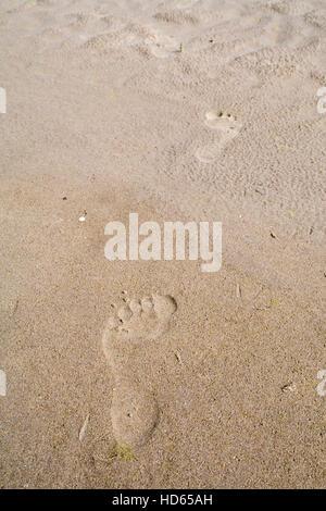 Foot prints in sand, North Berwick, East Lothian, Scotland, UK - Stock Photo