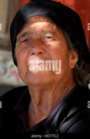 A portrait of an elderly Cypriot woman in the village of Pano Panagia, Pafos Region, Southern Cyprus. - Stock Photo