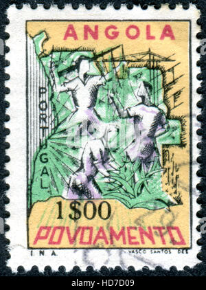 ANGOLA - CIRCA 1965: A stamp (Postal Tax) printed in Angola, shows the Map of Angola, industrial and farm workers, - Stock Photo