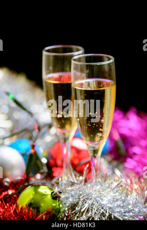 Cristmas glasses filled with champagne on cristmas decoration background - Stock Photo