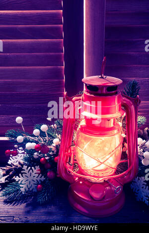Kerosene lamp in the night on the window outdoor, Christmas decorations - Stock Photo
