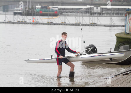 Putney, London UK. 10th December 2016. Rowing clubs practice on the River Thames in Putney on a grey dull day Credit: - Stock Photo