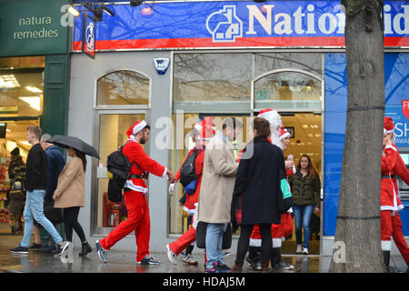 London, UK. 10th December 2016. Santacon London with hundreds of people dressed as Santa, Reindeer and Elves. - Stock Photo