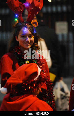 London, UK. 10th Dec, 2016. A young woman dressed as a reindeer during the annual 'Santacon' walk.  Described on - Stock Photo