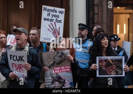 London, UK. 10th December 2016. A group of animal rights campaigners demonstrated against unethical and cruel practices - Stock Photo