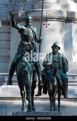 Bronze sculptures of Don Quixote and Sancho Panza at the Cervantes monument, Plaza de Espana, Madrid, Spain. - Stock Photo