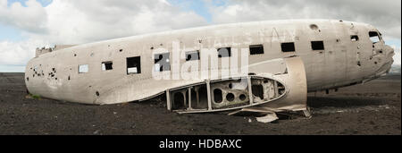 Iceland - Solheimasandur - United States Navy DC-3 aeroplane wreck side view panorama - Stock Photo
