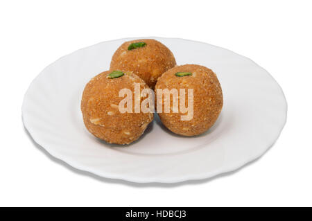 Indian sweets on a plate isolated over white - Stock Photo